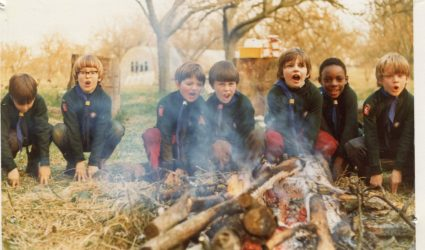 Cubs gathered around a fire.