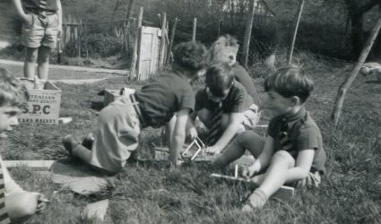 Boys on the grass at Little stream