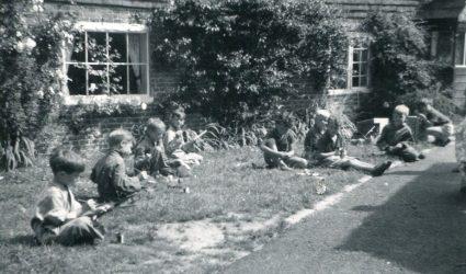 Children outside Little Stream