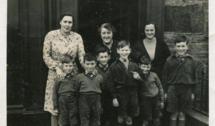 A group of Teachers and Boys.