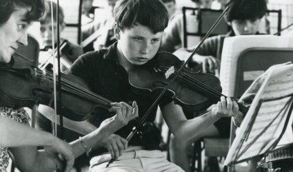 Boys playing Violins